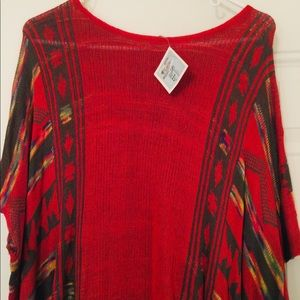 Aztec Red short sleeve pull over. Fits loosely.